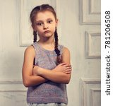 unhappy kid girl in stylish... | Shutterstock . vector #781206508