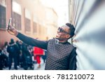 handsome black man with mobile... | Shutterstock . vector #781210072