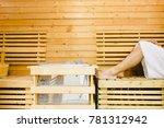 close up man leg on wooden seat ... | Shutterstock . vector #781312942