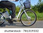 riding e bike or electric...   Shutterstock . vector #781319332