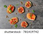 tasty bruschettas with tomatoes ... | Shutterstock . vector #781419742