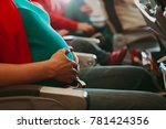 pregnant woman travel by plane | Shutterstock . vector #781424356