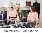 sales consultant helping... | Shutterstock . vector #781455472