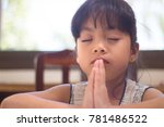 little girl praying in the... | Shutterstock . vector #781486522