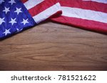 screwed up usa flag on brown... | Shutterstock . vector #781521622