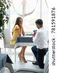 proposal in restaurant. man... | Shutterstock . vector #781591876