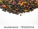 Small photo of Aromatic, pungent, black tea with dry berries and flowers. Side view.