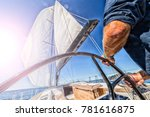 man driving sailing boat in... | Shutterstock . vector #781616875