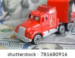 a toy car on money background | Shutterstock . vector #781680916