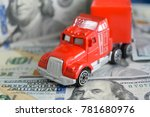 a toy car on money background | Shutterstock . vector #781680976