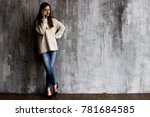 a young woman in a beige... | Shutterstock . vector #781684585