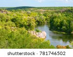 a blue river flowing between... | Shutterstock . vector #781746502