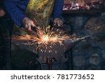 the blacksmith manually forging ... | Shutterstock . vector #781773652