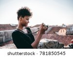 focused young curly african...   Shutterstock . vector #781850545
