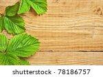strawberry leaves on wooden...   Shutterstock . vector #78186757
