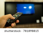 man hand using remote control... | Shutterstock . vector #781898815
