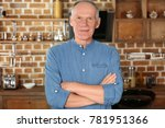 attractive mature man in casual ... | Shutterstock . vector #781951366