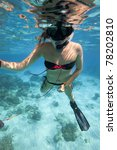 Girl free diving in the ocean, Andaman Sea, Thailand. - stock photo