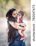 5 month cute baby girl in arm... | Shutterstock . vector #782047672