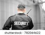 Male security guard using portable radio outdoors