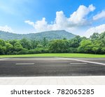 country road and mountains with ... | Shutterstock . vector #782065285