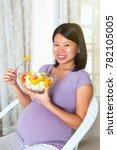 asian pregnant woman eating... | Shutterstock . vector #782105005