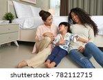 little asian girl  her mother... | Shutterstock . vector #782112715