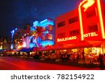 Small photo of Miami Beach, FL, USA November 30 The neon lights of South Beach foretell of an exciting nightlife scene on Ocean Drive in Miami Beach, Florida