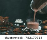 pouring tasty hot chocolate... | Shutterstock . vector #782170315