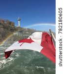 Canadian Flag With Rainbow At...