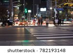 People Crossing The Street At...