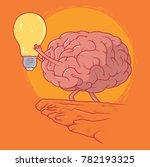 brain lifting lightbulb in a... | Shutterstock .eps vector #782193325