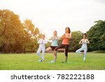 yoga at park.family couple... | Shutterstock . vector #782222188