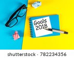 Small photo of New year goal, text on notepad with office accessories. Business motivation, inspiration concepts. 2018 Goals