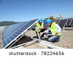 engineers checking solar panels ...