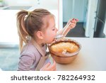 hungry four years old girl... | Shutterstock . vector #782264932