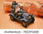 santa claus on the car carries... | Shutterstock . vector #782291608