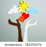 human's raised up hands holding ... | Shutterstock . vector #782293276