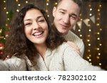 happy couple taking selfie and... | Shutterstock . vector #782302102