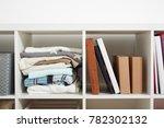 white rack with shelves full of ...   Shutterstock . vector #782302132