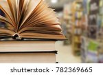 open book on stack books | Shutterstock . vector #782369665