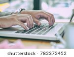 close up of hands using mobile... | Shutterstock . vector #782372452