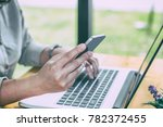 close up of hands using mobile... | Shutterstock . vector #782372455