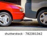 Cars are parked on the street very tightly to each other. A common way of parking in large European cities. - stock photo
