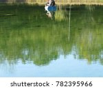 two people fishing in a boat on ... | Shutterstock . vector #782395966