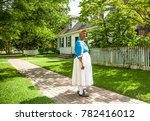 Small photo of Williamsburg, Virginia, USA - 6/21/2009: A woman dressed period clothing as a scullery maid, in Colonial Williamsburg.