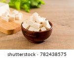 cube tofu on wooden board... | Shutterstock . vector #782438575