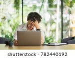 shot of stressed asian business ... | Shutterstock . vector #782440192