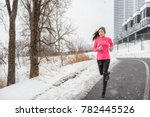 winter running asian girl... | Shutterstock . vector #782445526