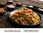 fried rice in plate on table in ... | Shutterstock . vector #782585332